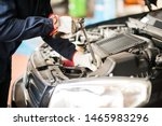 Detail Of An Auto Mechanic At...
