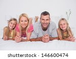 parents lying in bed with their ... | Shutterstock . vector #146600474