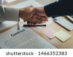 Small photo of closeup.handshake business partners agree to contract Real Estate Venture International trade,contract investment in meetings vision to invest for profit