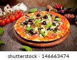 italian pizza served on wood   Shutterstock . vector #146663474
