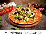 italian pizza served on wood | Shutterstock . vector #146663483