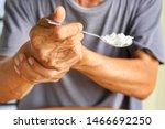 Elderly man is holding his hand ...