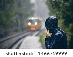 Man In Drenched Jacket Standing ...