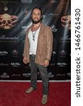 Small photo of Tyler Gallant attends Illuminated: The True Story Of The Illuminati Los Angeles Premiere at The Venue of Hollywood, Hollywood, CA on July 30 2019
