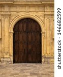 An Wooden Door Within Ornate...