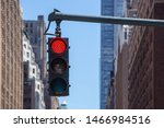Small photo of Traffic light closeup with red signal. Traffic light on the background of skyscrapers in New York. Red color traffic light with buildings in the background. Traffic light wallpaper.