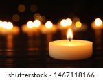 Burning Candle On Black Table...