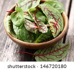 Young Beet Leaves In A Wooden...