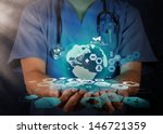 Medical Doctor Holding A World...