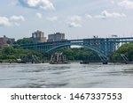 The Henry Hudson Bridge is connecting Northern Manhattan to the Bronx. This bridge is double -decked bridge. The upper level carries northbound traffic and the lower one is for southbound traffic.