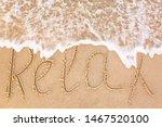 "Word ""relax"" Written On Sandy..."