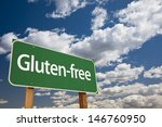 Small photo of Gluten-free Green Road Sign Over Dramatic Blue Sky and Clouds.