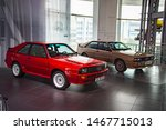 Small photo of Ingolstadt, Germany - April 9, 2019: Two Audi Quattro 1980s cars: 'Sport Quattro' rare rally Group B homologation 1984 racing car in red and an usual road Audi Quattro serial production car.