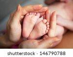 Baby's Foot In Mother Hands...