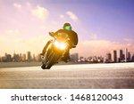 Man Riding Sport Motorcycle...
