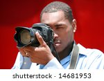 a photographer prepairs to take a photo with his digital camera - stock photo