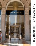 Small photo of Milan, Italy - July 29, 2018: Tiffany & Co. store. Tiffany and Company (known colloquially as Tiffany or Tiffany's) is an American luxury jewelry and specialty retailer