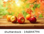 Apples On Wooden Table Over...