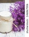 yogurt and purple flowers | Shutterstock . vector #146867006