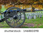 A Cannon In A Cemetery At...