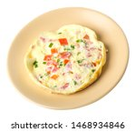 omelet with tomatoes and green...