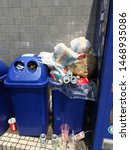 Small photo of Asakusa, Tokyo, Japan - August, 23, 2019 - Blue recycle rubbish bin, garbage can overflowing with soda cans. Tourists are often confounded by Japan lack of public rubbish bins, garbage cans.