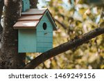 Wooden Blue Birdhouse On A...