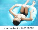 Wet kid having happy time on summer swimming pool - stock photo