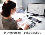 Businesswoman Calculating Tax...