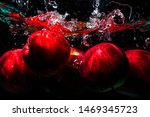 Fresh Red Apple Splashing Into...