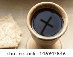chalice with wine and bread.... | Shutterstock . vector #146942846