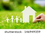 hand hold house against green... | Shutterstock . vector #146949359