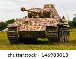 German Panther medium tank since World War II stands in a field