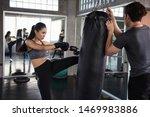 Asian Female Boxer Kick...