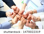 Small photo of Close-up of smart people performing cooperation gesture to greet presumptive boss or colleagues and show increased level of cohesion and solidarity. Company meeting concept