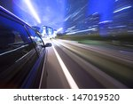 night drive with car in motion. | Shutterstock . vector #147019520