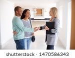 female realtor shaking hands... | Shutterstock . vector #1470586343