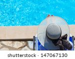 woman relaxed by the pool | Shutterstock . vector #147067130