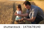 Father Farmer Plays With Littl...