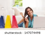 beautiful woman paying by... | Shutterstock . vector #147074498