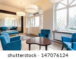 Elegant interior, hall with turquoise chairs and pouf - stock photo