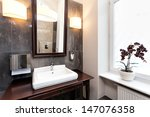 Interior of a classy bathroom with original furniture - stock photo