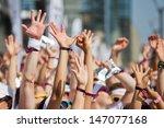 Crowd Of People Raising Their...