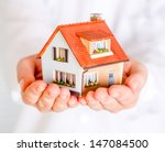 House In Human Hands On A Whit...