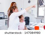 a doctor showing a young family ... | Shutterstock . vector #147084980