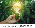 hand holding light bulb against ... | Shutterstock . vector #1470857090
