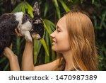 Woman Holding A Rabbit....