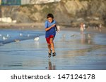 Young Boy Plays And Runs In Th...