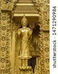 Standing Golden Buddha Statue...