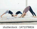 Small photo of Two boys learn yoga practice from their mother, have a healthy lifestyle, instill a love of sport from childhood, spend time together, conscious parenting.